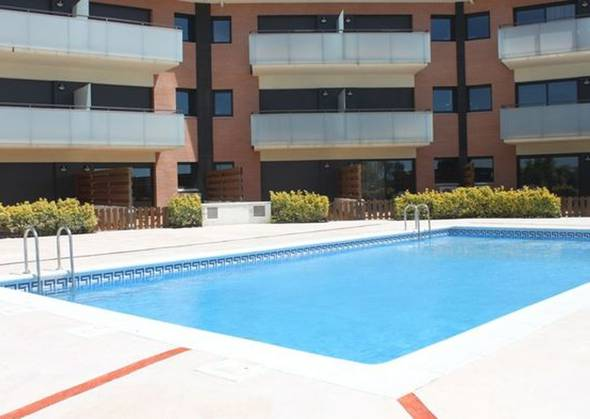 Outdoor swimming pool alegria chic apartments  santa susanna